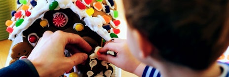 Children making gingerbread houses and creating positive memories. This cheerful picture was found at www.education.com .