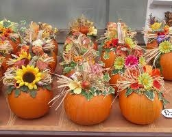 Pretty flower arrangements tucked into pumpkins, from FrerichsFarms.com